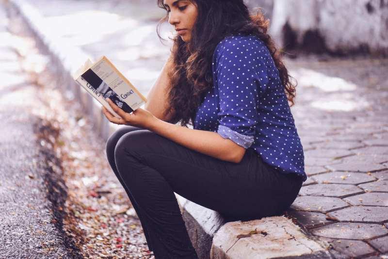 Female Author Reading Book